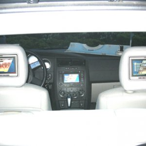 "7"" screens in headrest, and a modified FACTORY Nav unit."